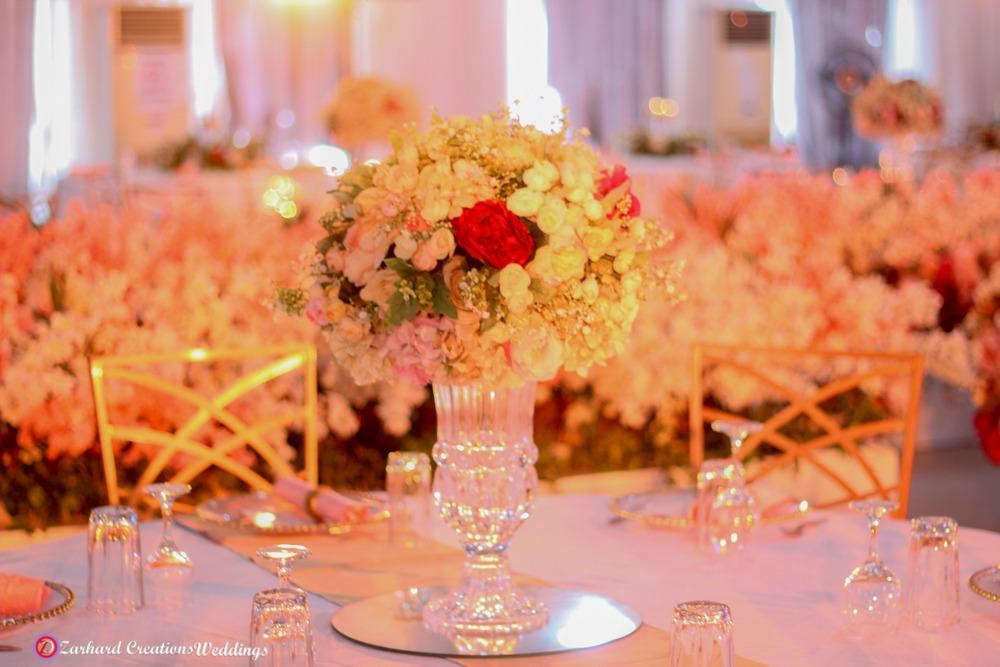 beautiful lush centerpieces with accent red and green colors
